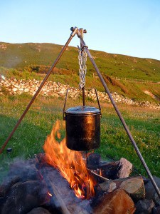 Campfire cooking with tripod